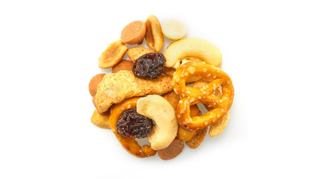 Pretzels [unbleached enriched wheat flour (flour, niacin, reduced iron, thiamine mononitrate-b1, riboflavin-b2, folic acid), salt, malt, soybean oil], peanuts, white cocoa butter drops [sugar, cocoa butter, whole milk powder, skim milk powder, soy lecithin (emulsifier), vanilla and natural flavour], peanut butter drops [sugar, hydrogenated palm kernel oil, partially defatted peanut flour, skim milk powder, whey powder, peanut butter (roasted peanuts, hydrogenated rapeseed and cottonseed oil), dextrose, salt, soy lecithin (emulsifier)], cashews (cashews, canola oil), raisins (raisins, sunflower oil); sesame sticks [enriched wheat flour (unbleached wheat flour, malted barley flour, niacin, reduced iron,thiamine mononitrate, riboflavin, folic acid), soybean oil, sesame seeds, bulgur wheat, salt, beet powder (colour), turmeric (colour)].